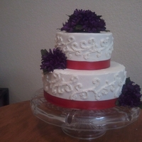 Small Wedding Cake   Small white wedding cake with red ribbon and purple flowers