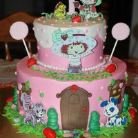 Strawberry Shortcake 2 Tier Cake I used edible images for the characters.