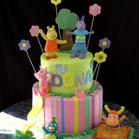 Backyardigans 2 Tier Cake All gumpaste figurines. My slide broke, but I was able to save enough to make it work.