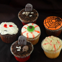 "Creepy Halloween Cupcakes These were so fun! I usually do ""cutesy"" cupcakes and cakes for Halloween, but the request was for weird and scary. The skulls I..."