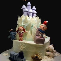 "Land Of Misfit Toys My favorite holiday show! Iced in buttercream with fondant figures and white chocolate ""ice shards"""