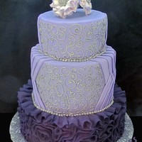 Purple Fondant Ruffle With Silver Piping Purple fondant ruffle with silver piping