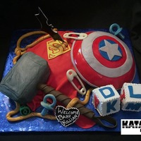 Superhero Themed Baby Shower Cake With Elements From Both Dc And Marvel Superhero themed baby shower cake with elements from both DC and Marvel
