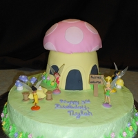 Tinkerbell And Friends Bday Cake Made a mushroom house for Tink using the giant cupcake mold. Covered in fondant. Round cake is covered in cream cheese. Made welcome sign,...