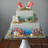 Tropical Beach Cake  I created this for a bridal shower. Shells and coral are made of chocolate. Chairs and fence are gum paste. Thanks to the CC'er for...