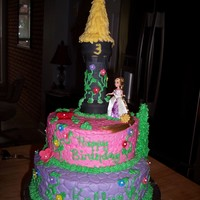 Tangled Rapunzel Loved this cake. All butter cream with fondant flowers. Tower is ice cream cones frosted with chocolate icing and then fondant