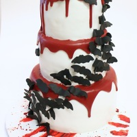 "A Play On The Wedding Cakes With The Cascading Butterfliesflowers I Used Candy Melt Ganache For The Blood The Bats Are Gum Paste The C A play on the wedding cakes with the cascading butterflies/flowers. I used candy melt ""ganache"" for the blood. The bats are gum..."