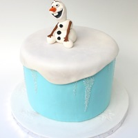 Olaf (From Frozen) Cake Olaf from Frozen. He is sculpted from gumpaste/fondant mix. Cake is chocolate with chocolate buttercream. Fondant covered with icicles made...