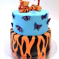 Tigger Cake With Purple Butterflies Tigger cake with purple butterflies for a sibling birthday party. One sibling wanted Tigger and the other purple butterflies. This was the...