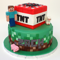 Minecraft Cake Both tiers are vanilla cake with vanilla buttercream covered in fondant. The tiles are all modeling chocolate (the greens are candy melt...