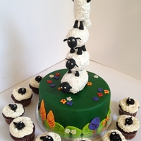 Shaun The Sheep Cake And Cupcakes Shaun the Sheep cake with sheep cupcakes for my daughter's 4th birthday. The cake is lemon with lemon curd and strawberry puree with...