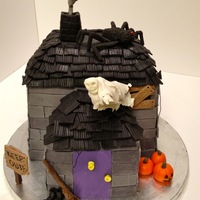 Haunted House Halloween Cake Haunted house cake. The siding is fondant, the roof tiles are modeling chocolate. The other decorations are gumpaste.
