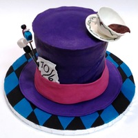 Mad Hatter Hat Cake The birthday girl specifically requested purple, pink, blue and black as a color scheme.