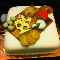 Cheese Platter/cheese Board Cake  This is a 2 layer vanilla cake with vanilla buttercream frosting and filling. The cake is covered with white fondant and decorated with...