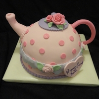Teapot Cake   cake in the shape of a teapot (tea pot). was made to match the plates/paper goods at the party