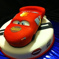 Lightning Mcqueen/ Cars Cake   Carved lightning McQueen cake on top of a 12 inch round cake decorated in CARS theme
