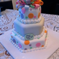 Fun And Funky   Three tiers, middle tier is a light tie-dye incorporating the colors from the bow.