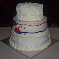 4Th Of July Cake the top tier is done in rosettes made of stabilized whip cream, middle tier is buttercream with mmf stars and wavy stripes, bottom tier is...
