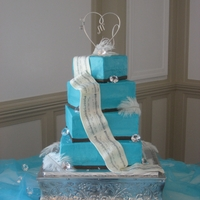 Musical Wedding Cake this cake is made in bc with mmf drape of sheet music. accented with some of the table decorations on feathers and jewels