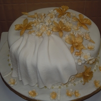Single Tier Wedding Cake this was a single tier wedding tht i made with gold orchids ....the theme color was gold