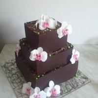 Chocolate Wedding Cake   Hi, you can see my second chocolate cake. Fondant orchids. Green balls as an accent. TFL xx