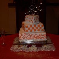 Tn. Vols Wedding This wedding cake was done for a TN. Vols Football Team wedding theme. The Cake was done in the Traditional White cake with my White...
