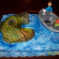 Gone Fishing Birthday cake for a Dad from his little girl, The 2 of them out fishing and she catches the big one and he gets a minnow!!!