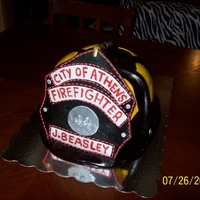 Firefighter Helmet The cake is White Chocolate with Buttercream filling covered in buttercream fondant.