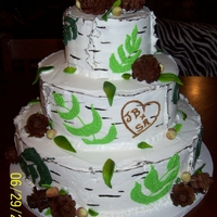 Burch Tree Wedding Cake Classic white cake covere in my homemade wondercream icing with handmade pinecones, acorns, and leaves.