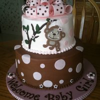 Monkey Themed Baby Shower 7 inch yellow cake with raspberry filling, 10 inch banana cake with chocolate buttercream. Inspired by shower invitation. Monkey cut from...