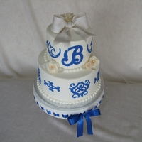"Monogram Blue And Silver Bridal Shower Cake 6"" and 9"" chocolate cake. Cricut Cake cutouts in blue. Fondant bow with chocolate roses and leaves"