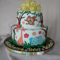 Baby Shower Jungle Theme Cake 7 and 10 inch buttercream chocolate cake. Fondant bow and letters. Everything else is modeling chocolate cut with my Cricut Cake. TFL.