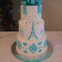 """parisian Chic"" Themed Baby Boy Shower Cake 6"",8"",10"" tiered cake. Tiffany blue Eiffel tower with fondant teddy bear and poodle on either side. Onsie, diaper pin,..."