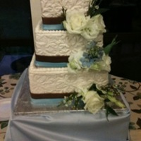 Square Embossed 3 Tier Wedding Cake Embossed Off White fondant, Ribbons in fondant, fresh flowers
