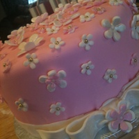 Baby Shower Pink Flowers Fondant covered, pink and white flowers accented with lustre dust. Fondant Bow