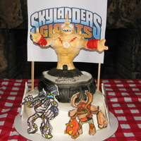Skylanders Cake- I Sculpted The Character On Top And Handpainted The Other Fondant Cut Outs.