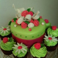 Pink And Green Baby shower cake with matching cupcakes...I love the colors!