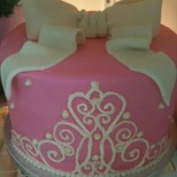 Pink Tiara Cake   buttercream with a piped tiara disign and fondant bow topper