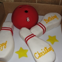 Bowling Cake My friends son was having a party at the bowling alley, so I did this cake for him! Bowling ball and pins are all cake, covered in fondant...