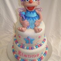 "Abby Cadabby 6"" & 8"" cake covered & decorated in MMF with lots of disco dust. Abby is RKT, modeling chocolate & MMF."