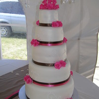 Fuschia & Brown Wedding Cake  This cake was made purely out of love - and I couldn't pass up the challenge! My cousin was getting married and I offered to do the...