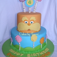 The Lorax For my girlfriend's twin boys, for whom I've done a birthday cake for since their first birthday! All fondant. Buttercream grass...