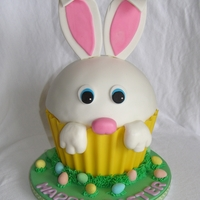 Easter Bunny Giant Cupcake Chocolate shell, all the rest is fondant. Buttercream grass and Cadbury mini eggs at base.