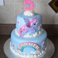 "My Little Pony  5"" & 8"" cakes covered & decorated in fondant. Pony (Starsong) is gumpaste, clouds around the borders and on top are..."