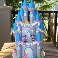 "Disney Castle These are 5"" & 8"" cakes covered in fondant, with 10 turrets from the Wilton Romantic Castle set, also covered in fondant...."