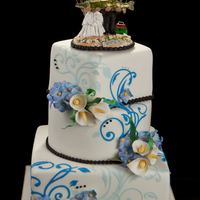 Last Wedding For Today fondant cake, gumpaste flowers and accent designs. Topper is ceramic.