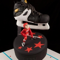 Hockey Bar Mitzvah Cake Customer came to us looking for a very special cake for their son's Bar Mitzvah. The theme: Hockey. The Team: Red Wings. What better...