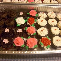 Assorted Chocolate Cuppies Dark chocolate cuppies topped with Ri flowers, buttercream roses, sprinkles