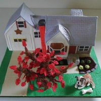 Housewarming This cake was made as a housewarming gift. I was asked to recreate their new house as well as include their dog in the yard. The cake is a...