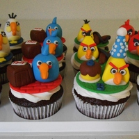 Angry Birds And Pigs I made these for a set of twins for their 6th birthday. I tried to find scenes from the games. They are chocolate cupcakes with buttercream...
